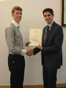 Ashley receives his certificate and cheque from James Wren (Prosig UK)